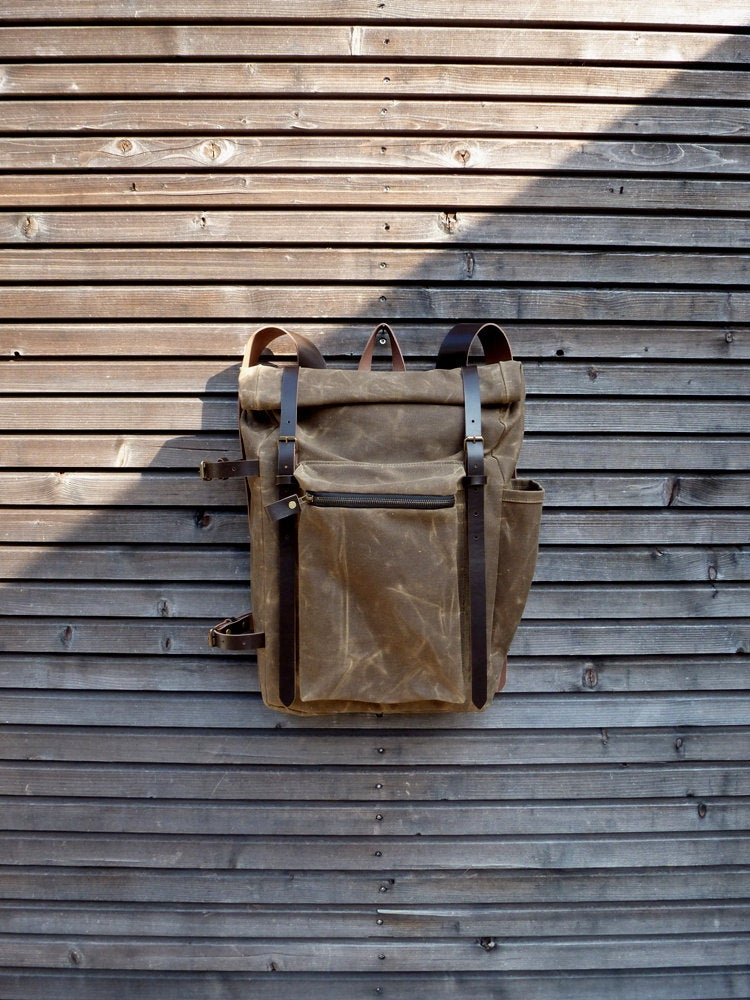 Image of Waxed canvas backpack with bottle pocket and side leather side straps