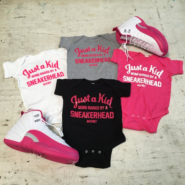 """Image of JUST A KID BEING RAISED BY A SNEAKERHEAD """"PINK/WHITE"""" (INFANT)"""