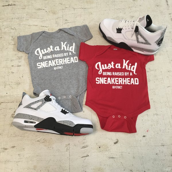 """Image of JUST A KID BEING RAISED BY A SNEAKERHEAD """"RED/GREY W/WHITE PRINT"""" (INFANT)"""