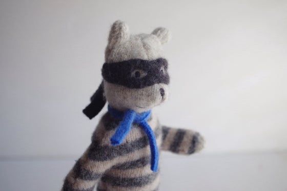Image of Rowdy Raccoon, small posable wool toy