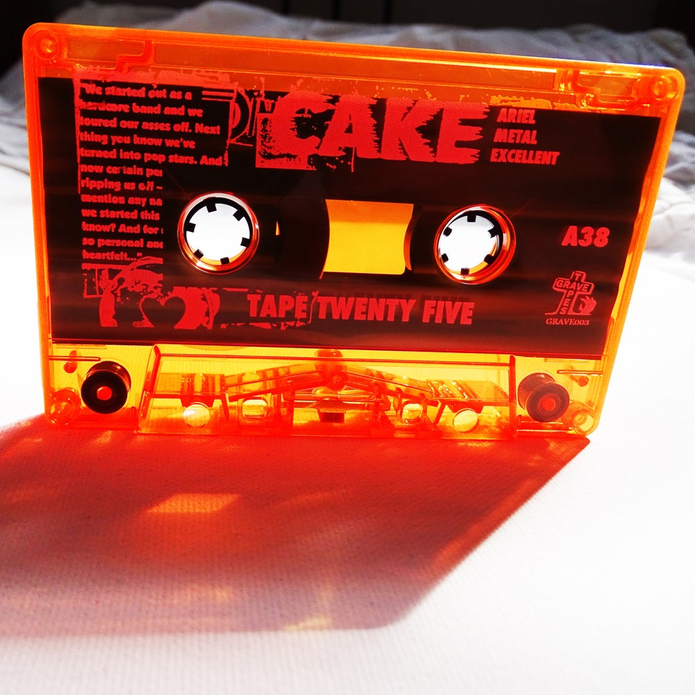 Image of CAKE (UK) - TAPE TWENTY FIVE - Limited Edition Transluscent Orange Cassette - (GRAVE 003)