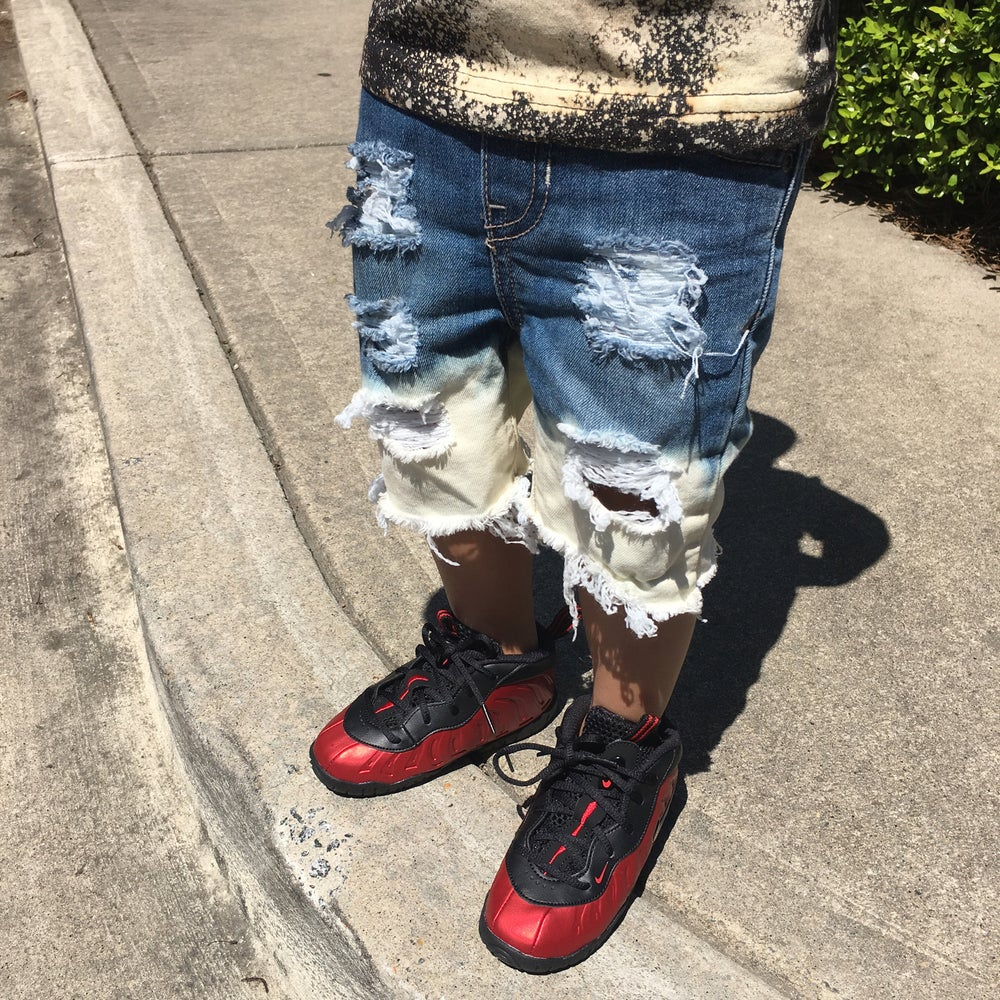 Image of Distressed bleached jean shorts