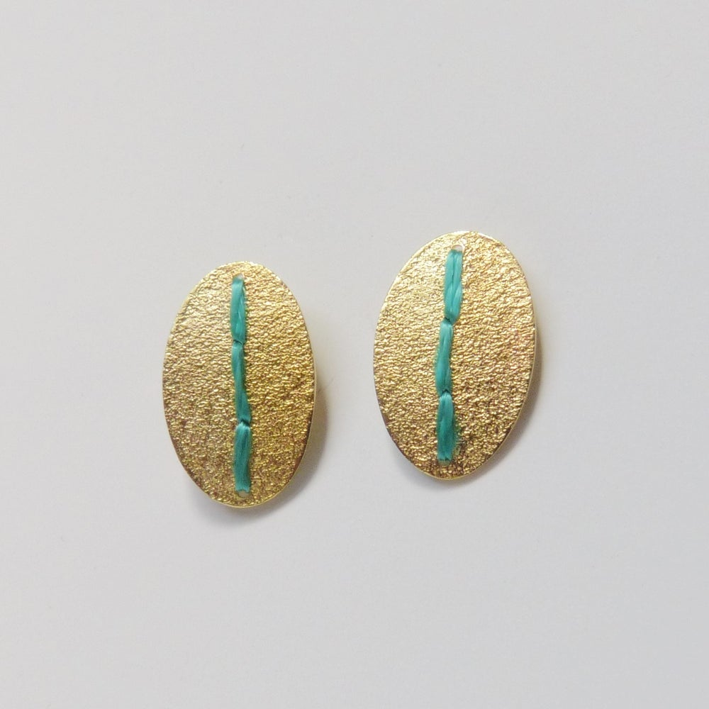 Image of Sewn Up Small oval studs