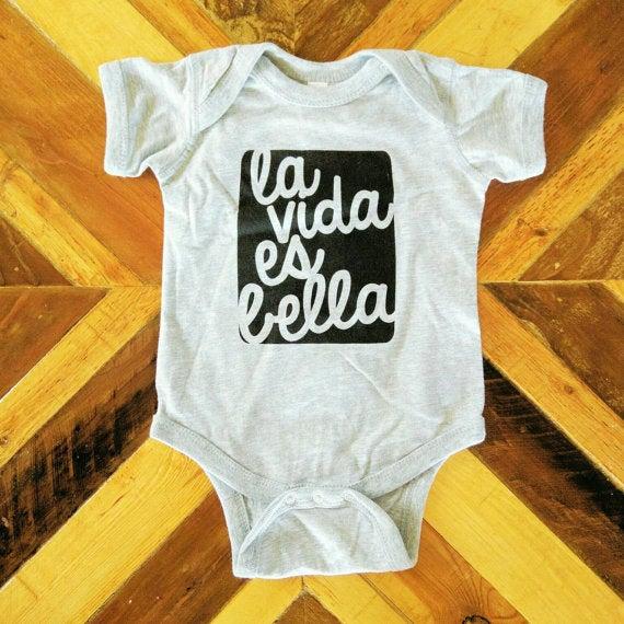 Image of La Vida es Bella ) Infant Onesie or Infant Tee