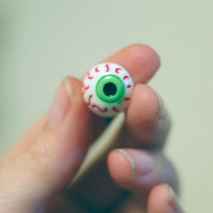 "Image of Green Eyeball Plugs (sizes 2g-1/2"")"
