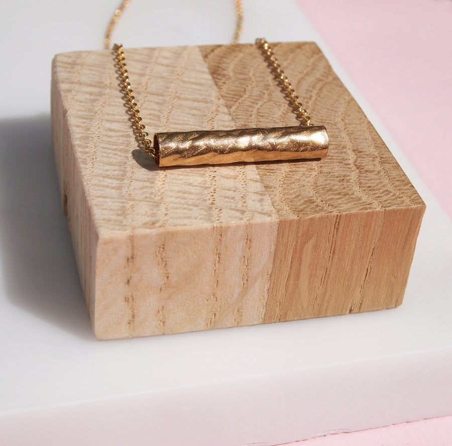 Image of gold barrel necklace