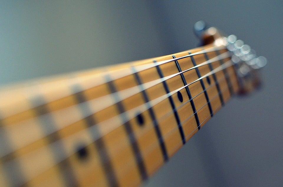 Image of Encordoamento de guitarra