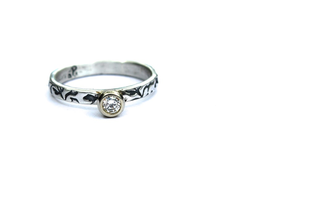 Image of canadian diamond engagement ring . sterling silver