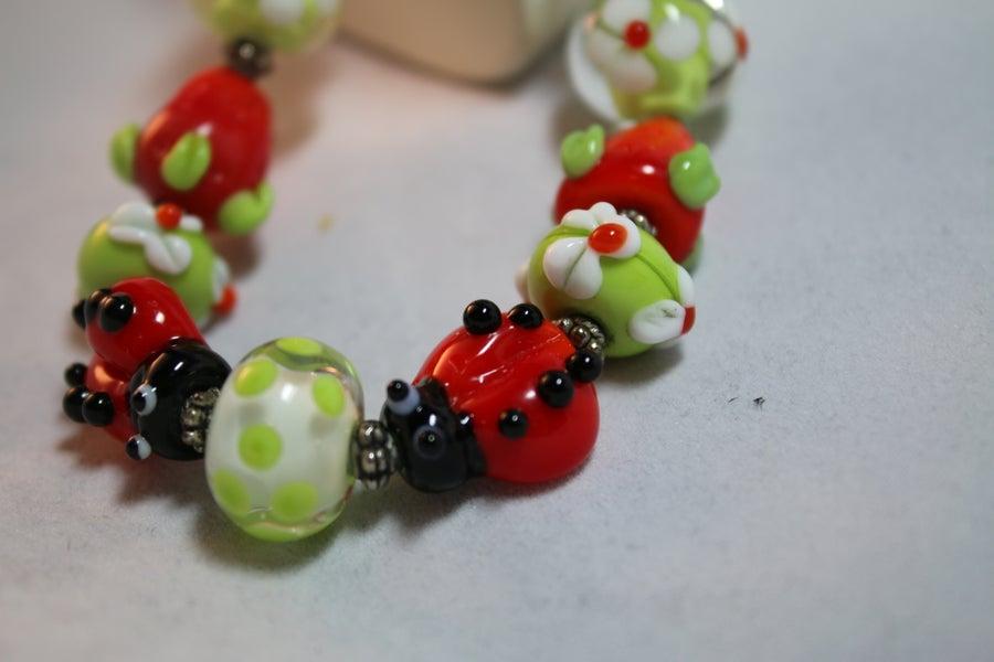 Image of Flower garden lampwork bracelet
