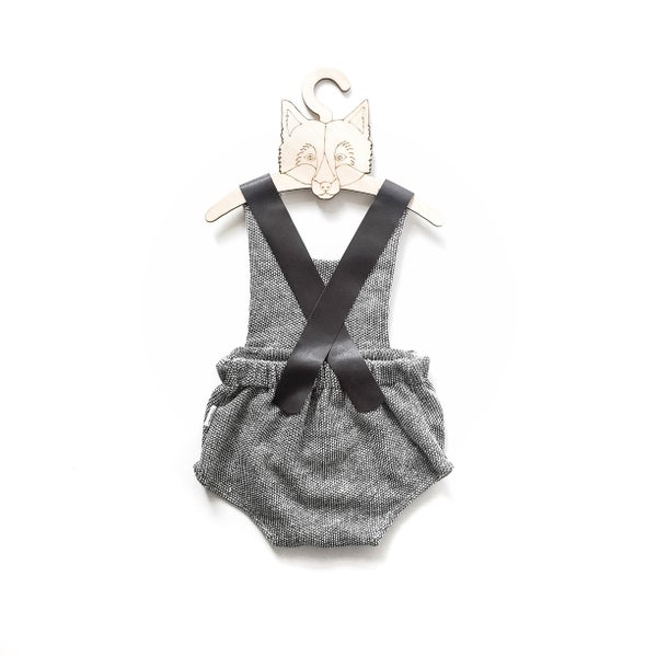 Image of leather strap playsuit in 'black snow' knit