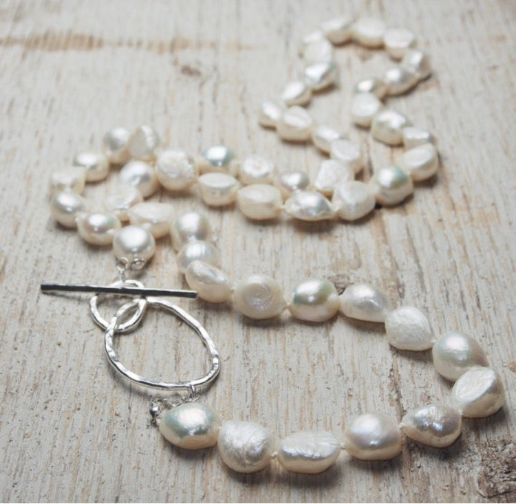 Image of long white baroque pearl necklace with sterling toggle clasp