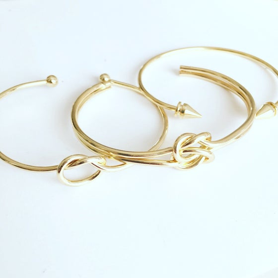 Image of Gold knot and spike bangle