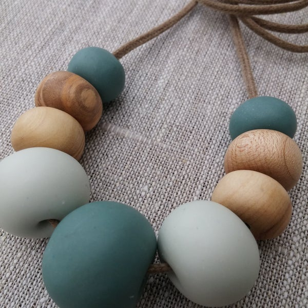 Image of Clay and eco wood necklace | 9 bead marine blue.
