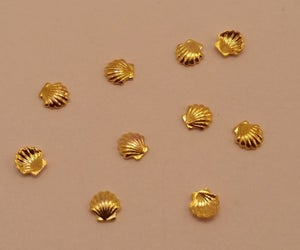 Image of Seashell charms (10 pcs) Gold or silver 3mm or 5mm