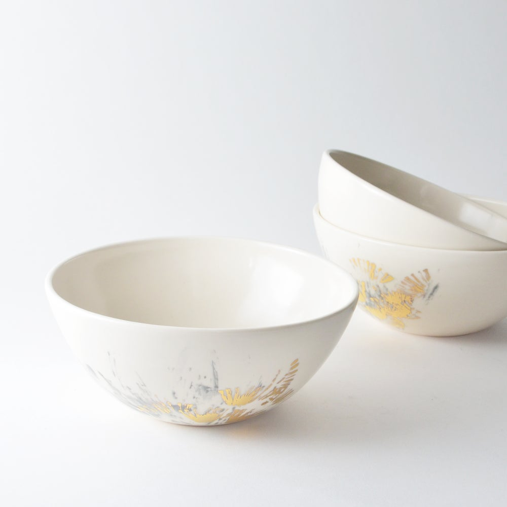 Image of silver and gold cereal bowl