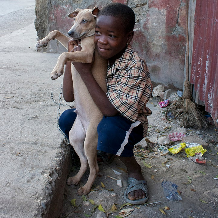 "Image of ""Boy with Dog"" Photo by Philomène Joseph"