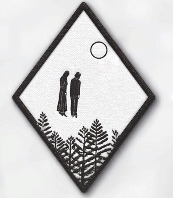Image of Meeting above the fog dipped pines woven patch