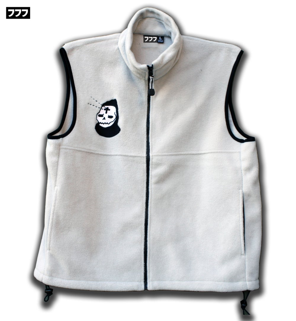 Image of light+dark fleece vest