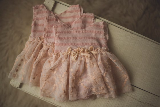 Image of Newborn Skirted Bow Romper
