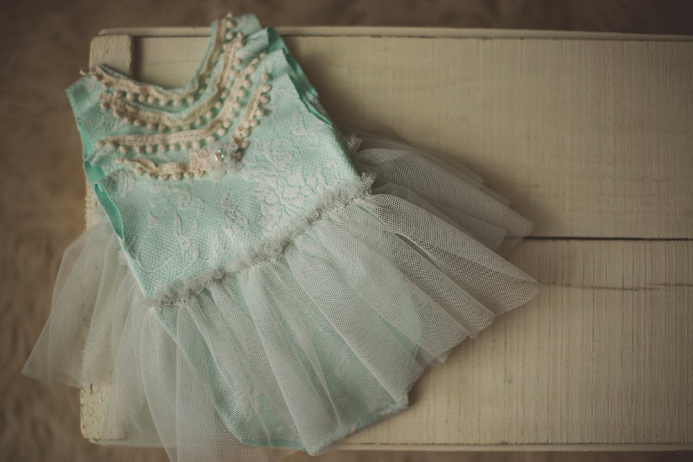 Image of Newborn Mint Skirted Romper