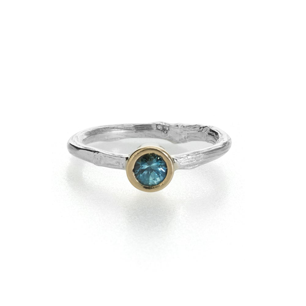 Image of Montana sapphire twig engagement ring . rose gold setting