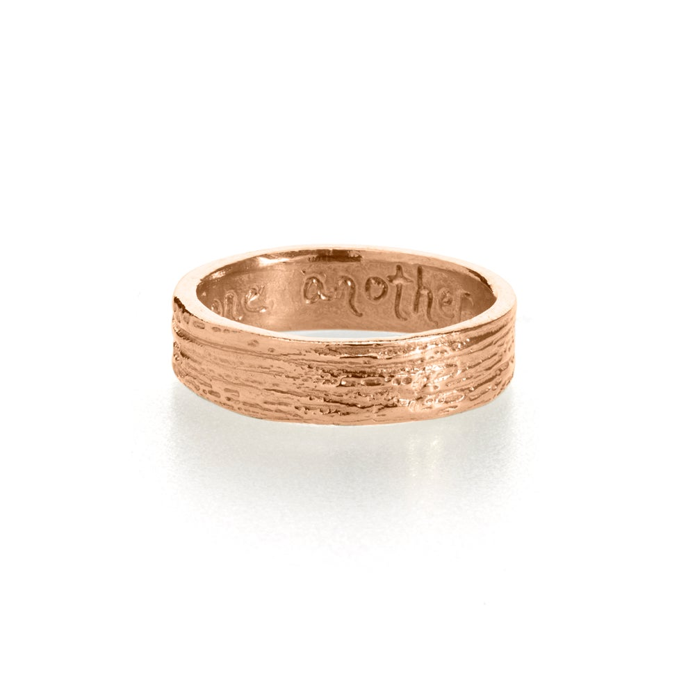 Image of woodgrain wedding band . 14k gold