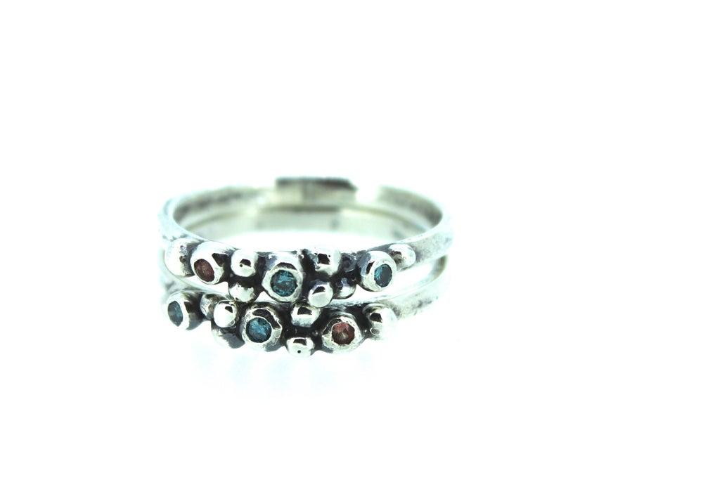 Image of bohemian teal diamond and orange sapphire ring
