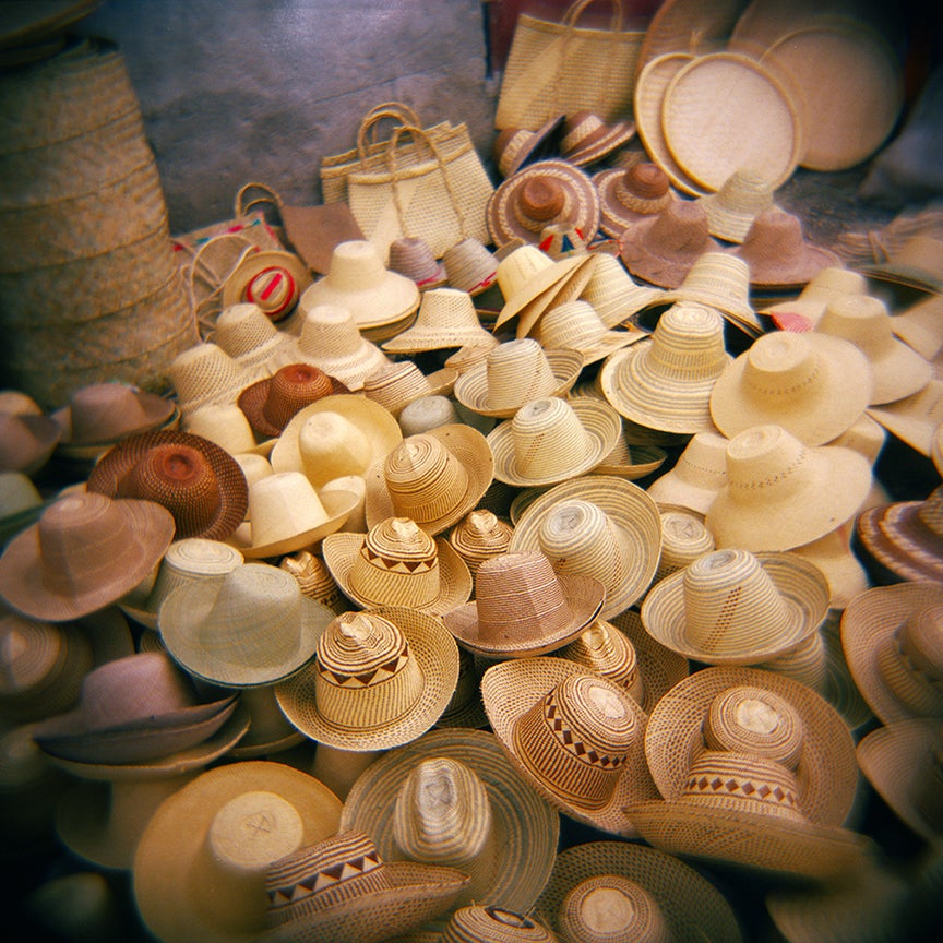 """Image of """"Hats in Camp Perrin"""" Photo by Smith Neuvieme"""