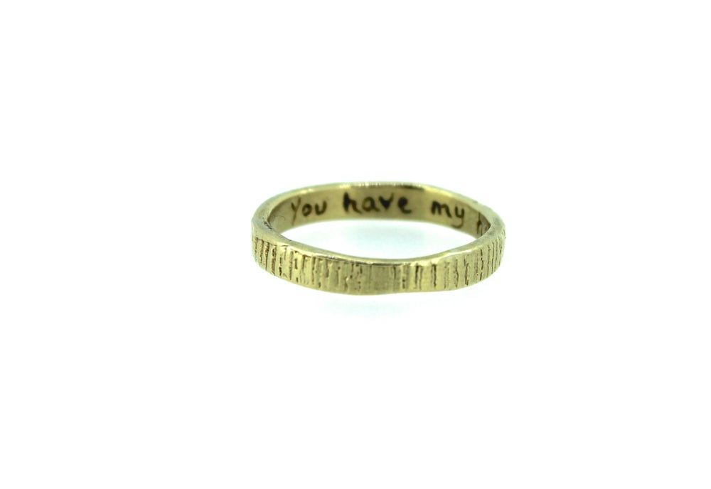 Image of thin woodgrain wedding band .14k gold