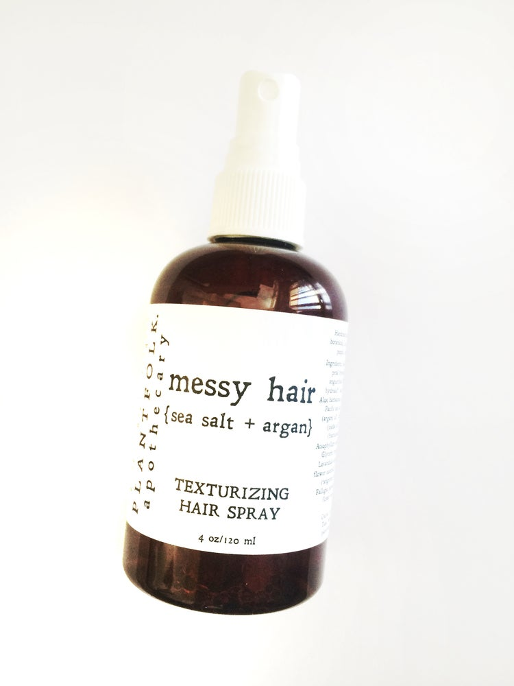 Image of messy hair {sea salt + argan} texturizing hair spray