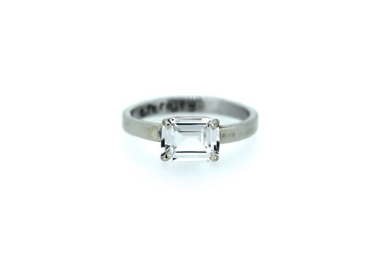 Image of emerald cut white sapphire engagement ring