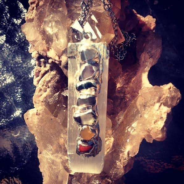 Image of Divine Authentic Beauty Chakra Pendant on Selenite