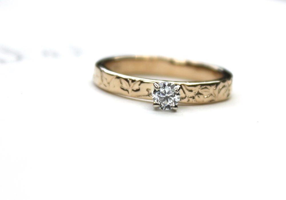 Image of petite moissanite engagement ring