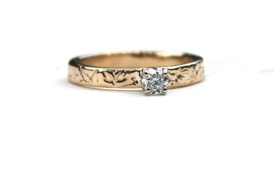 Image of petite moissanite engagement ring