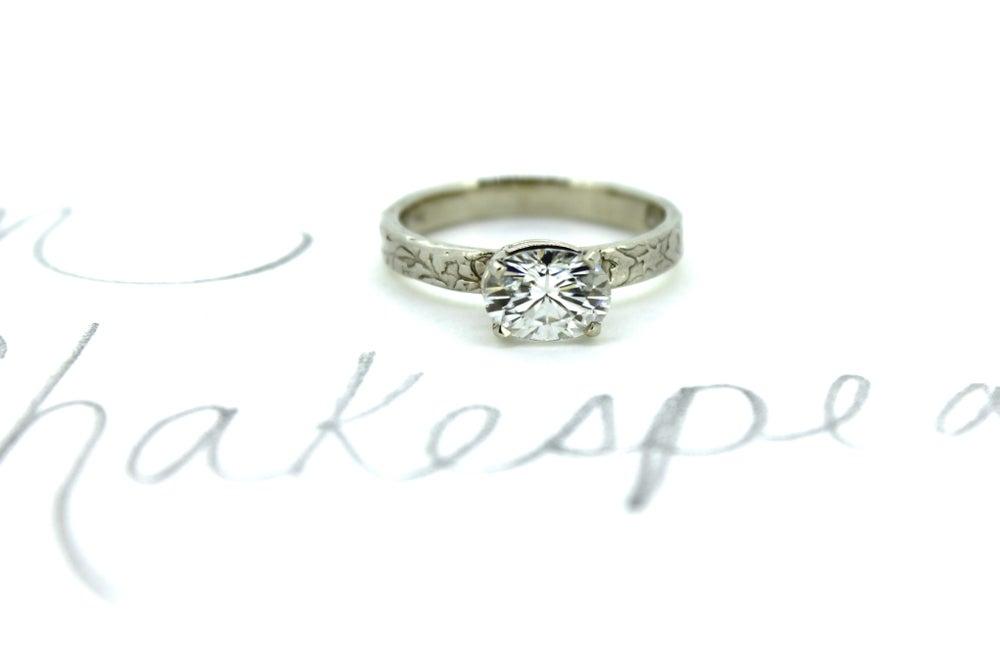 Image of oval moissanite engagement ring . 14k gold