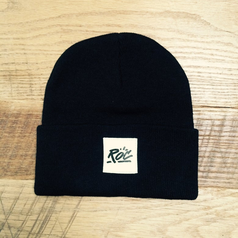 Image of Black Beanie w Sewn On White ROC Patch