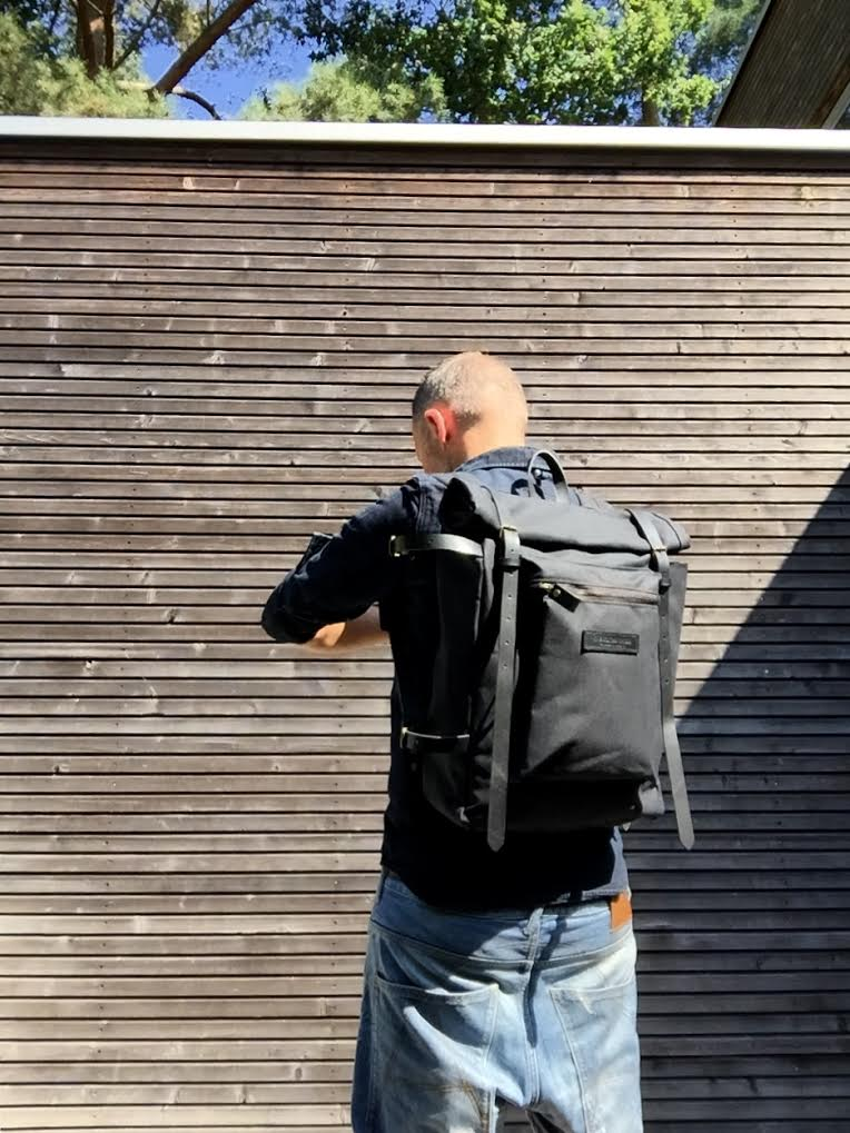 Image of Waxed canvas backpack with roll to close top and zipper outside pocket