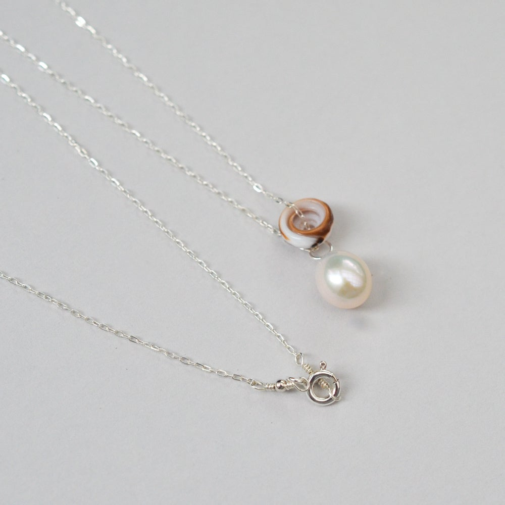 Image of Puka shell necklace cultured freshwater pearl sterling silver
