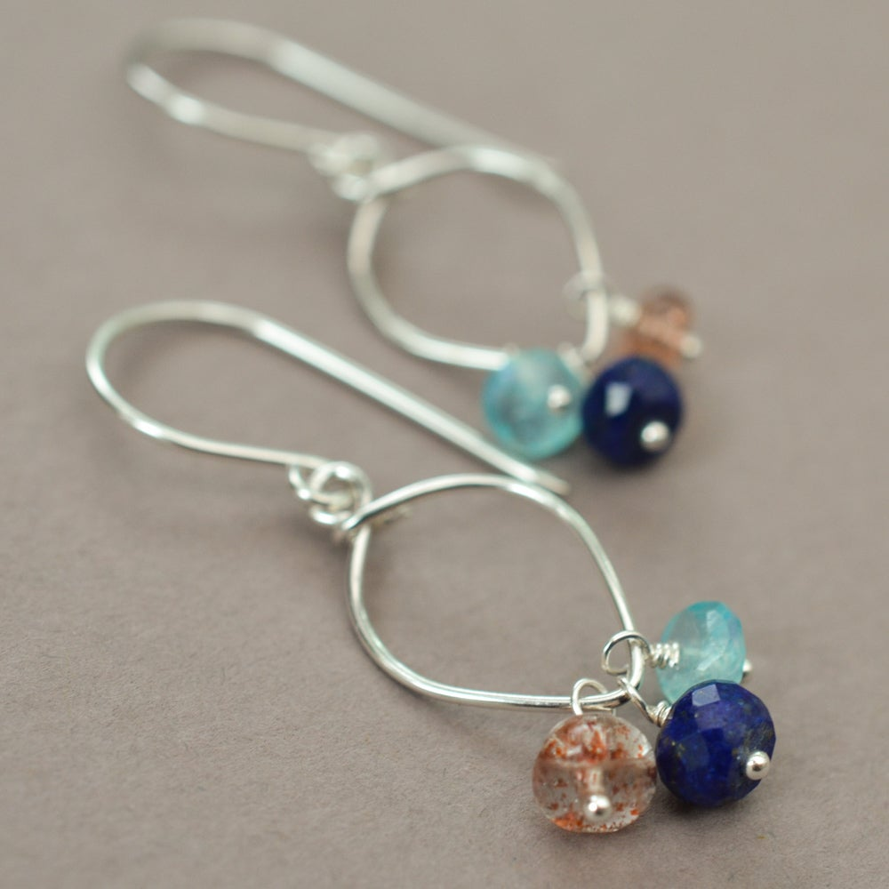 Image of Lapis lazuli earrings sterling silver sunstone rainbow moonstone lotus loop