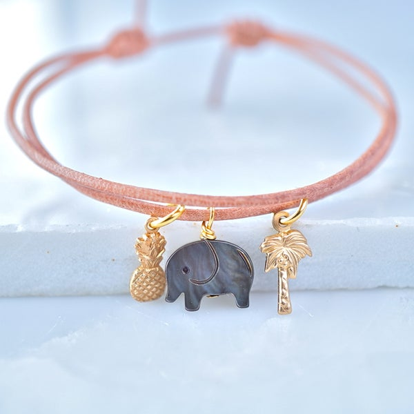 Image of Leather bracelet with elephant ,pineapple ,palm tree