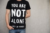 Image of 'You Are Not Alone' tee