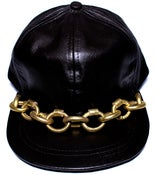 Image of Gold leather chain cap