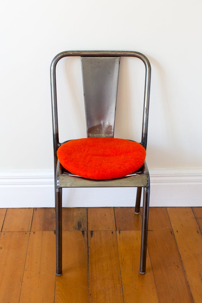 Image of Overly Orange Tush Cush