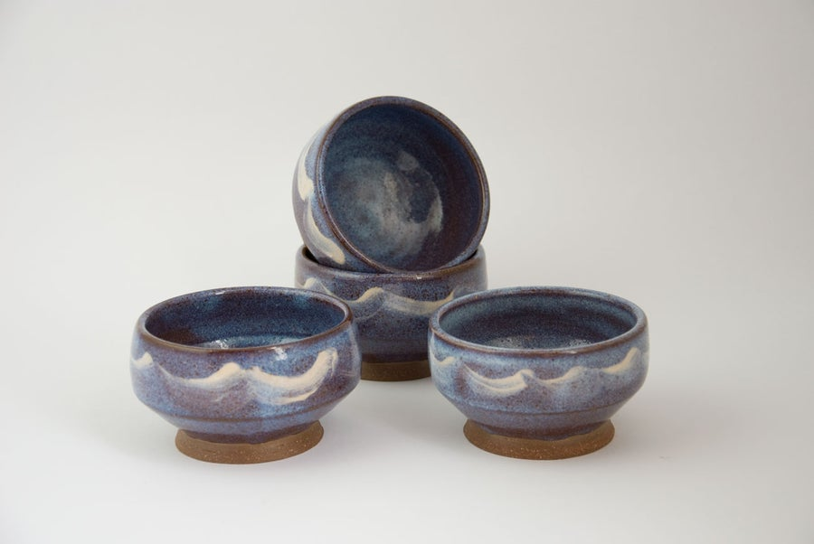 Image of blue tea bowl with slip decoration
