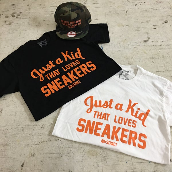 """Image of JUST A KID THAT LOVES SNEAKERS """"ORANGE PRINT"""" T-SHIRT"""