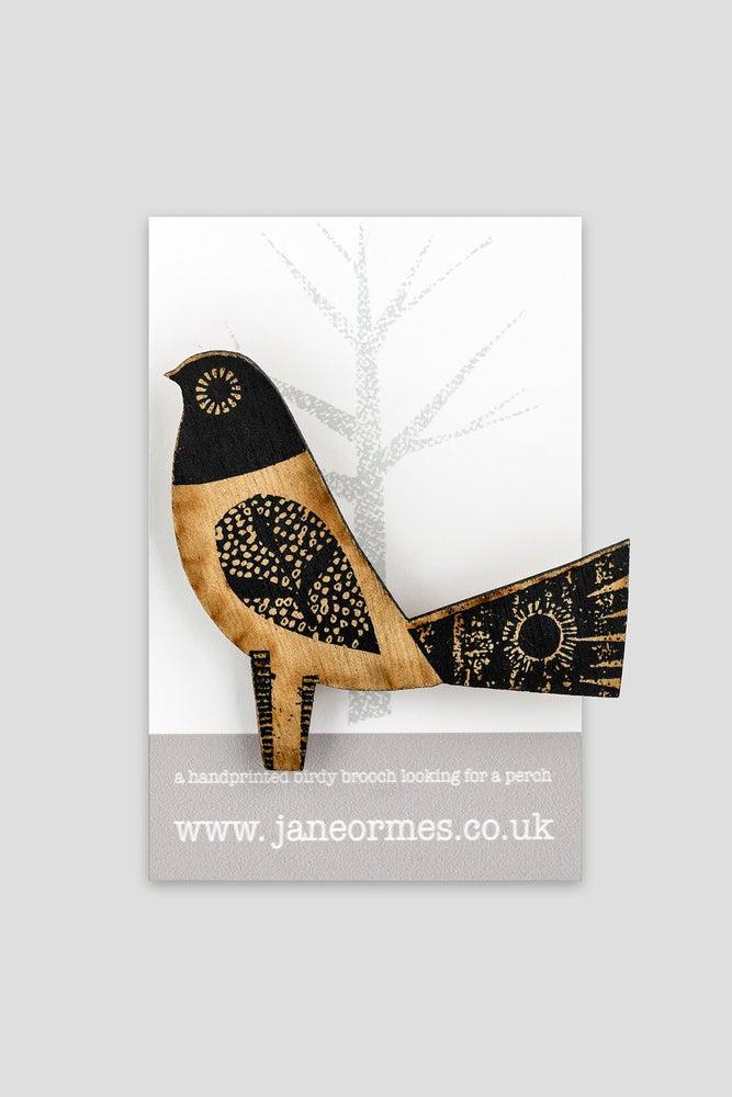 Image of Standing bird brooch