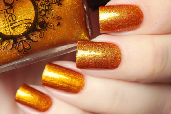Image of ~Golden Axe~ red to gold multichrome chrome w/silver flakes!