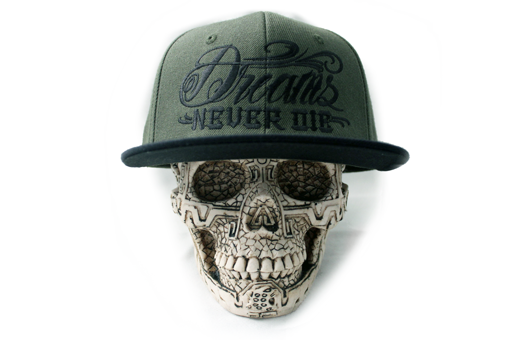 Image of DREAMS NEVER DIE FOREST GREEN SNAPBACK