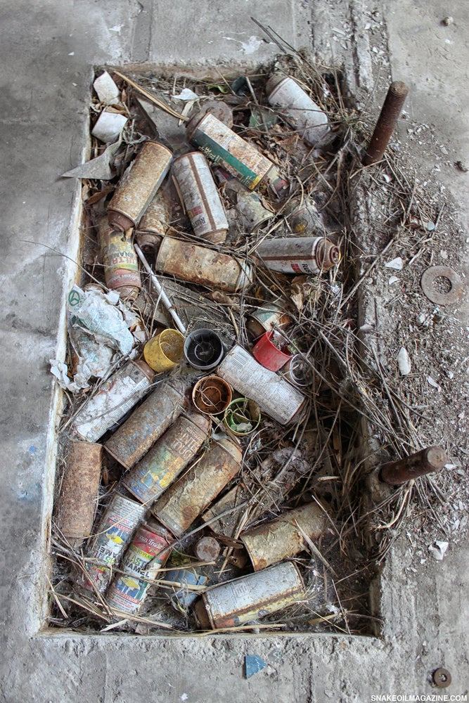 Image of Rusted Spray Paint Cans