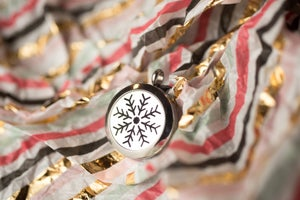 Image of NoDak Snowflake Essential Oil Diffuser Necklace